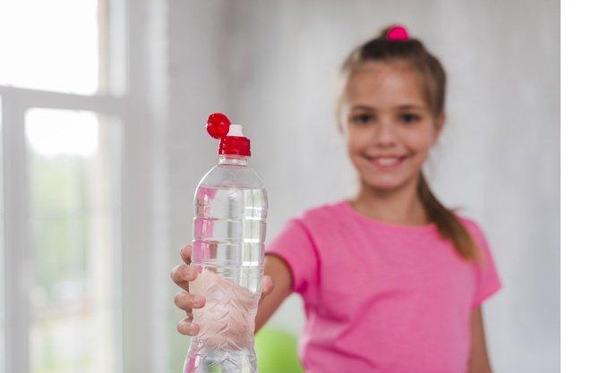 defocussed-girl-giving-plastic-water-bottle-toward-camera-23-2148186401.jpg