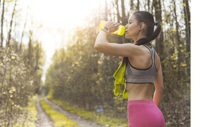 young-woman-drinking-water-nature-23-2148197321.jpg